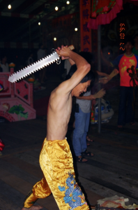 A tangki cutting himself with a jagged-tooth sword. Photo: Margaret Chan